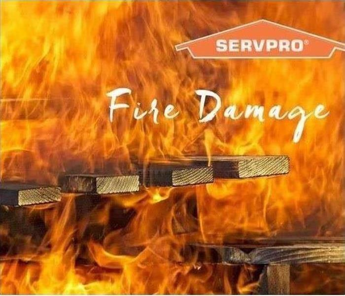 Stock image of SERVPRO with kitchen fire in background
